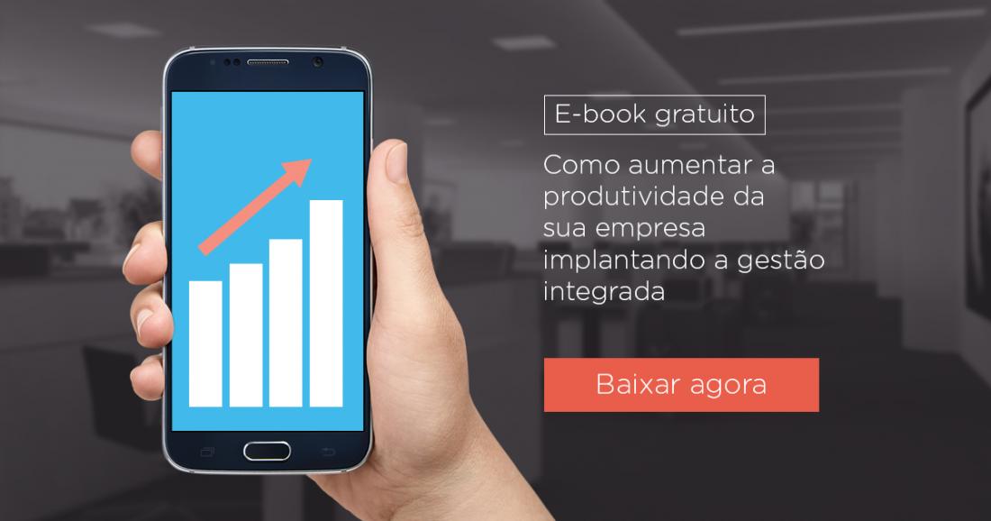 Mão segura celular, na tela aparece um gráfico crescente como uma seta. A imagem apresenta o texto: E-book gratuito Como aumenta a produtividade da sua empresa implantando a gestão integrada